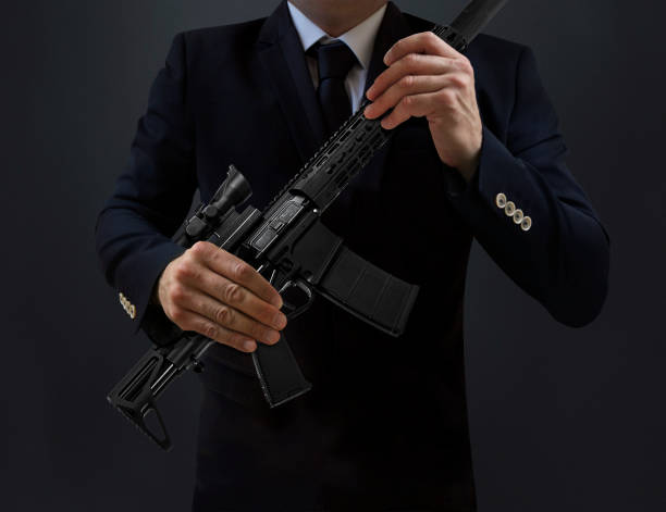 The Secret Service Agent Holding Machine Gun Stock Photo Download Image Now Istock