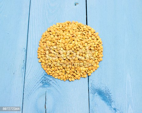 The Seeds Of Green Lentils On A Blue Board Stock Photo & More Pictures of Close-up