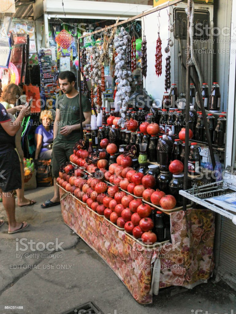 The seller of pomegranate and pomegranate juice. royalty-free stock photo