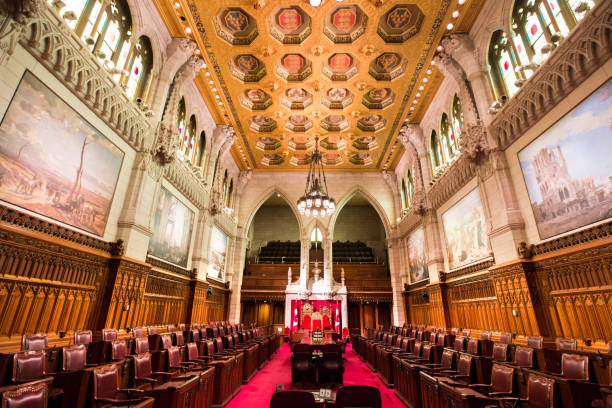 the senate chamber in the canadian parliament building - canada parliament stock photos and pictures
