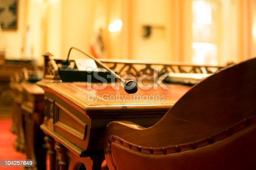 A microphone on the antique desk of a California State Senator. In the chambers of the California Senate in Sacramento.