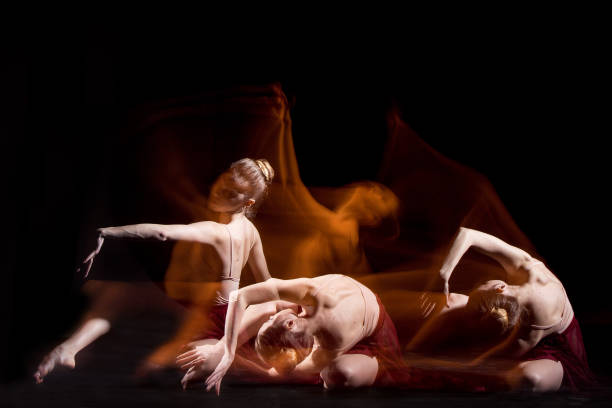the sensual and emotional dance of beautiful ballerina - dance group stock photos and pictures