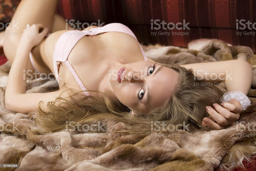 The sensual young woman lays on a floor. royalty-free stock photo