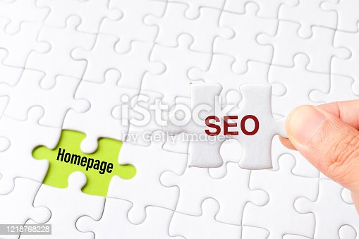 1045434476 istock photo The SEO (Search Engine Optimization) word on white jigsaw puzzle go to replace homepage word on green gap - idea answer concept. 1218768228