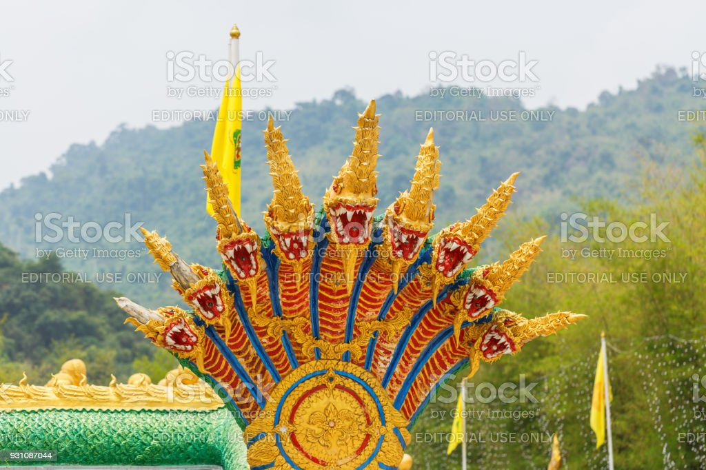 The serpent statues in countryside public temple named MAKHA BUCHA BUDDHIST MEMORIAL PARK in Nakornnayouk, Thailand. stock photo