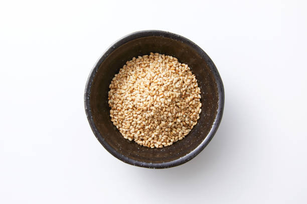 the sesame on white - sesame stock photos and pictures