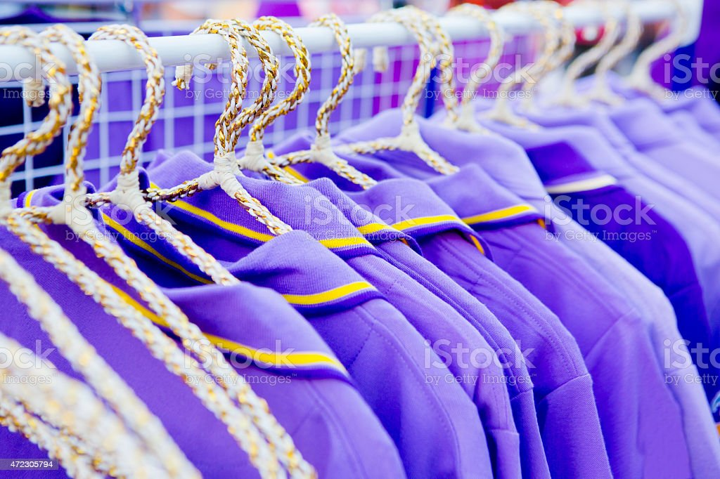 The set of purple T-shirts for sale. stock photo