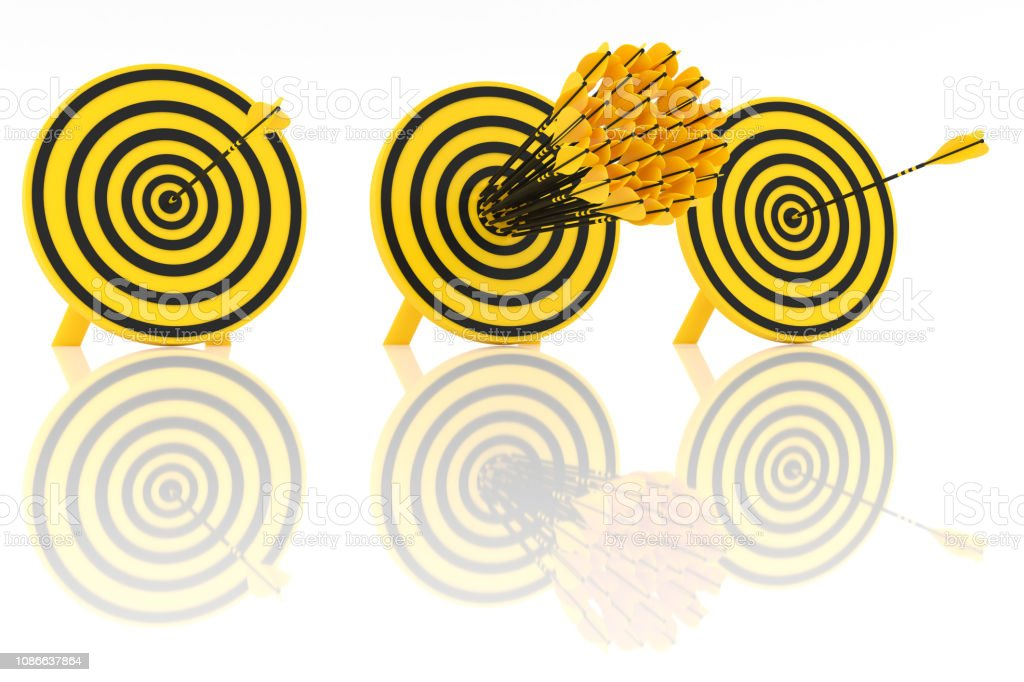The set of yellow arrows hit the center stock photo
