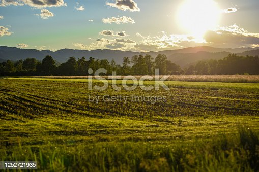 The setting sun photographed in a field in the countryside