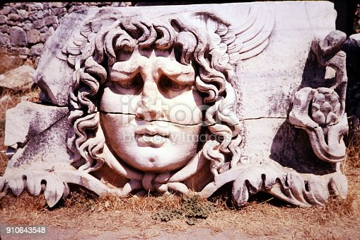 Turkey, June 1974.  A stone-carved Medusa head at the ruins of the Temple of Apollo at Didyma.