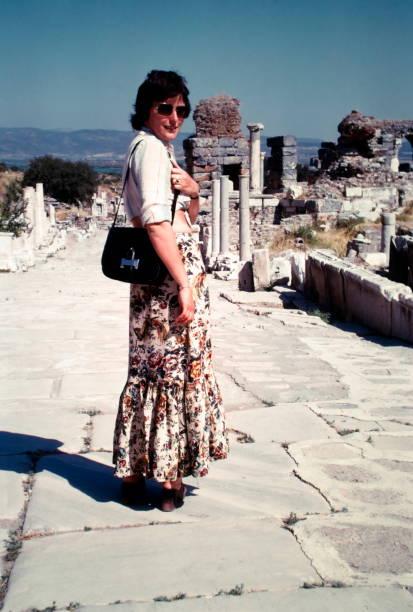 the seventies. a young woman at atemple near by ephesus, turkey. - viagens anos 70 imagens e fotografias de stock