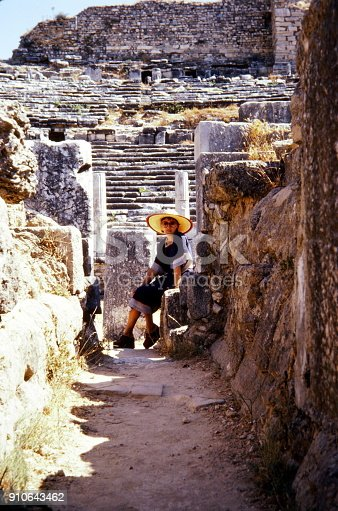 Turkey, June 1974.  A young woman with sun hat at the DidymaTemple of Apollo.