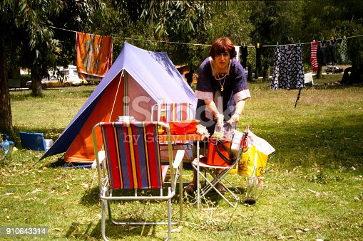 istock The Seventies. A young woman enroute at a camping place. 910643314