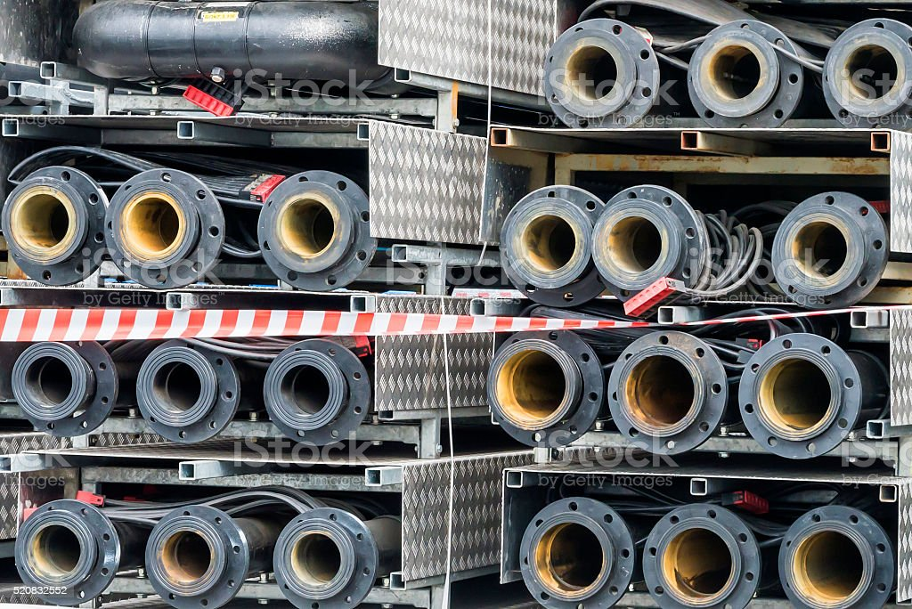 the sewer pipes are stored on open storage stock photo
