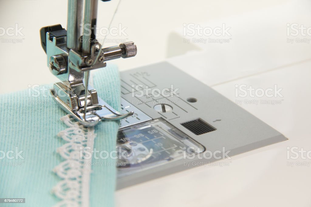 The sewing on the sewing machine the turquoise knitwear royalty-free stock photo