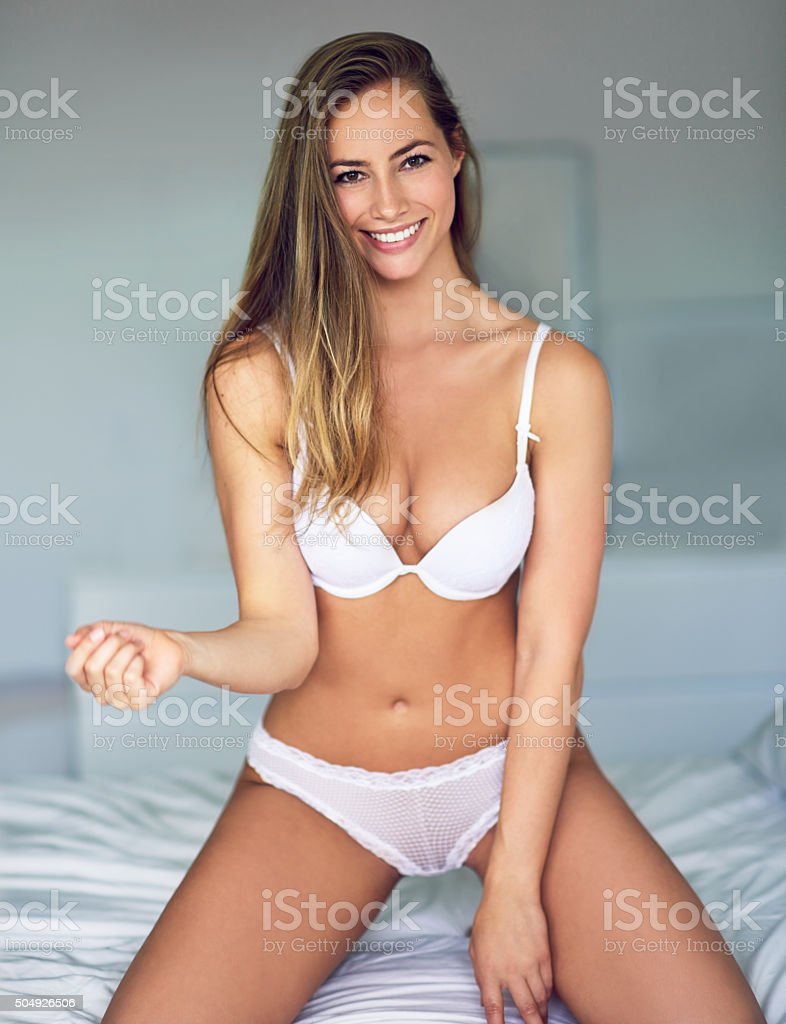 The sexiest curve on a woman's body is her smile stock photo