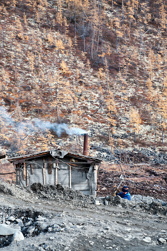Ust-Nera, Yakutia, Russia - September13, 2009: The shack is a hibara of a gold miner (prospector) in the taiga, in a remote mountainous area, where gold miners wash natural gold  Eastern Siberia, Yakutia (Oimikon district)