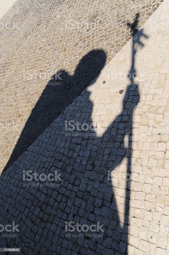 The shadow of Pope John Paul II statues stock photo