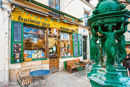 Paris, France - December 11, 2012: The Shakespeare and Co. bookstore on December 11, 2012 in Paris, Opened in 1951 by George Whitman, it serves both as a regular bookstore and as a reading library, specializing in English-language literature.