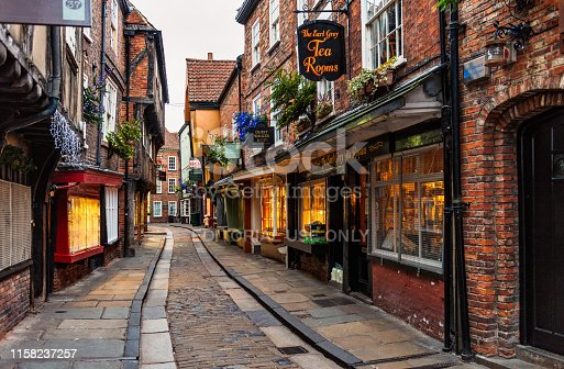 York, UK - Traditional shops on the famous and ancient narrow medieval street, the Shambles.