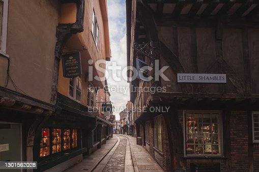 The Shambles in old town York, featuring traditional medieval timber frame overhang buildings, is a popular tourist attraction and shopping area.