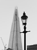 The Shard and old Victorian street light, juxtaposing the old and the new in Black and white.