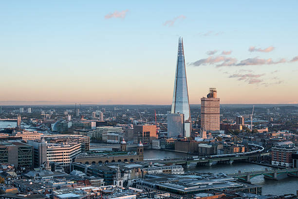 the shard building among a beautiful cityscape - shard london bridge stockfoto's en -beelden
