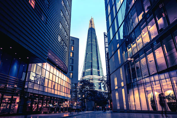 the shard in central london at dusk - international landmark stock photos and pictures