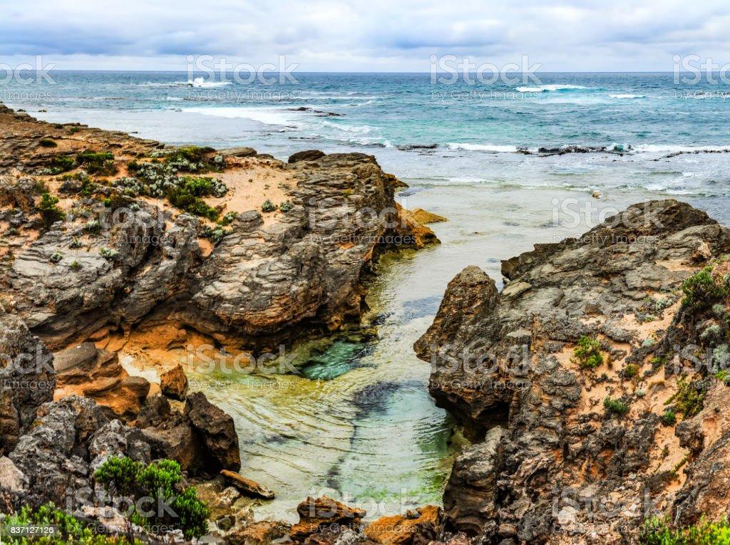 The sharp rocks on the Australian coast of the Pacific ocean stock photo