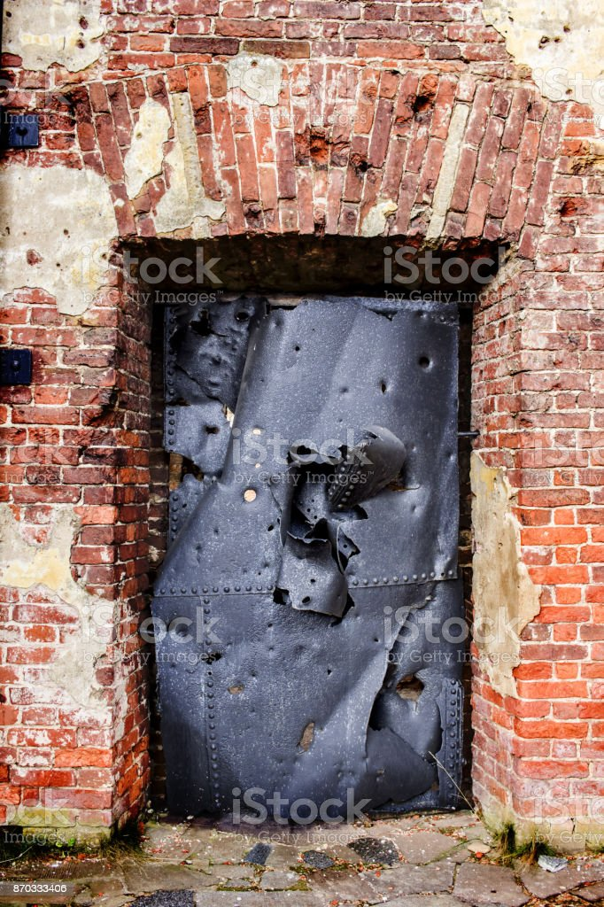 The Shell Hit The Metal Door Traces From The Explosion
