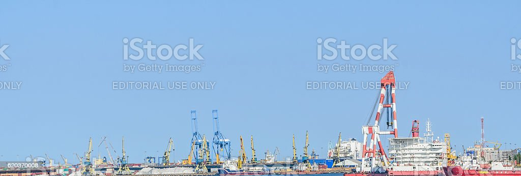 The ships at naval shipyard working with cranes zbiór zdjęć royalty-free
