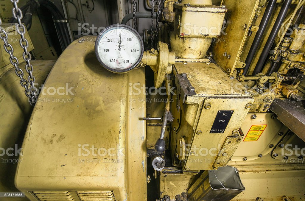The ship's hold with yellow diesel engine mounted on ship. stock photo