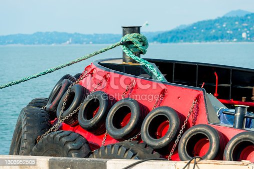 The side of the boat is hung with old tires to protect against impact.