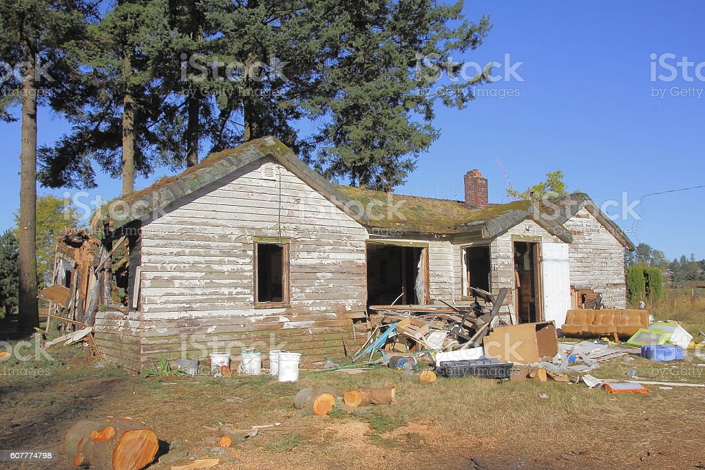 The side view of a small house currently being demolished stock photo