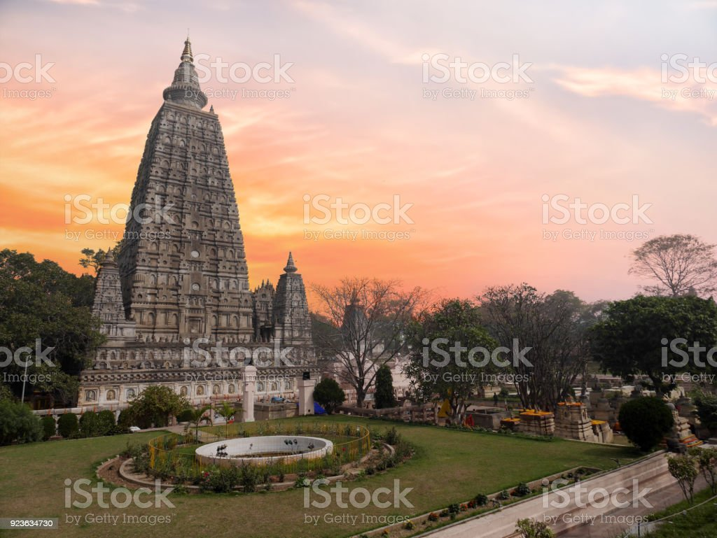 The side view of the stupa at Mahabodhi Temple Complex in Bodh Gaya, India. The Mahabodhi Vihar is a UNESCO World Heritage Site. stock photo