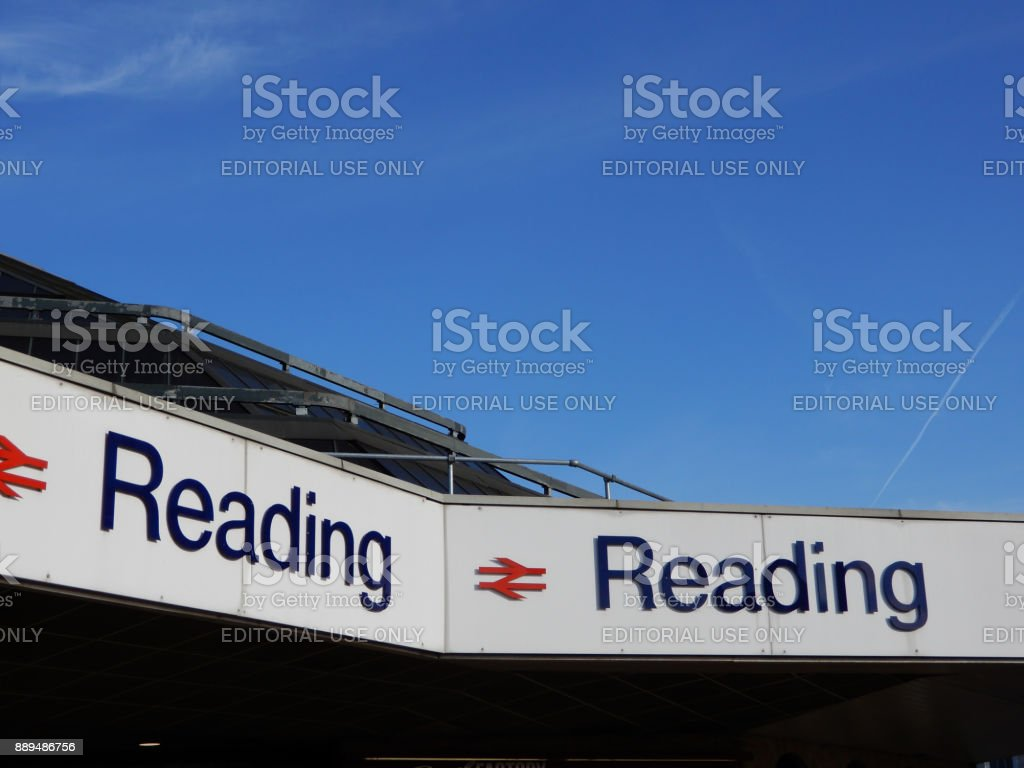 The sign above Reading Station against a blue sky stock photo