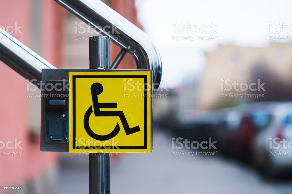 the sign for the disabled on the handrail stock photo