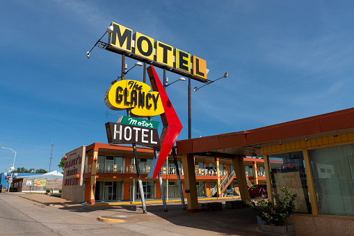 Clinton, Oklahoma, USA - July 8, 2014: The sign for The Glancy Motel, along the historic US route 66 near the city of Clinton, in the State of Oklahoma, USA.