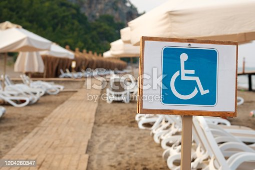 the sign is blue on a white background for the disabled there are places for people with disabilities. beach places for people with disabilities
