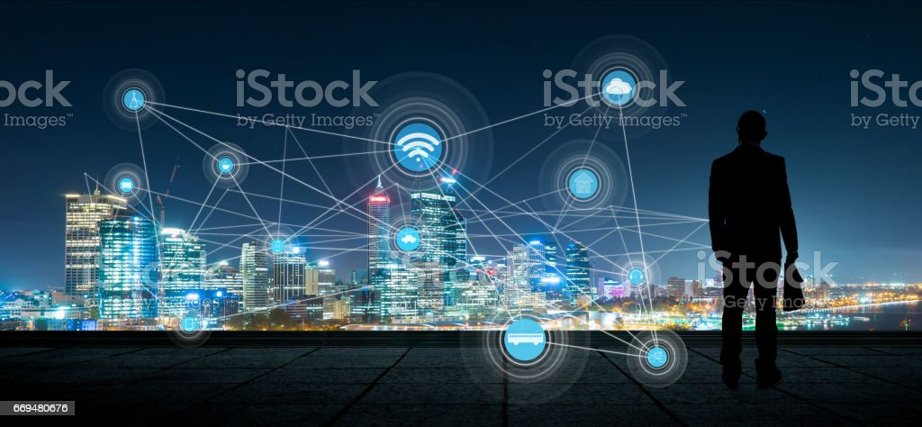 The silhouette businessman with city and wireless communication network background, abstract image visual, internet of things stock photo