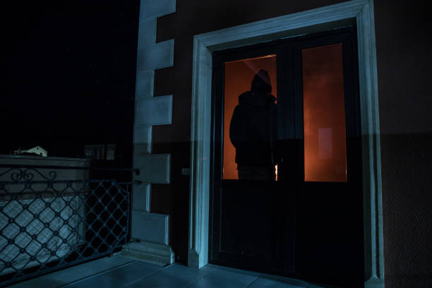 The silhouette of a human in front of a window at night. Scary scene halloween concept of blurred silhouette of maniac. – zdjęcie