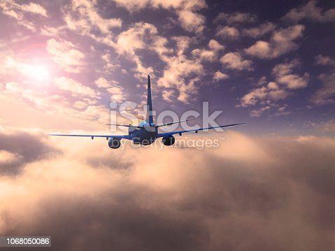 816320512 istock photo The silhouette of a passenger plane flying in sunset. 1068050086
