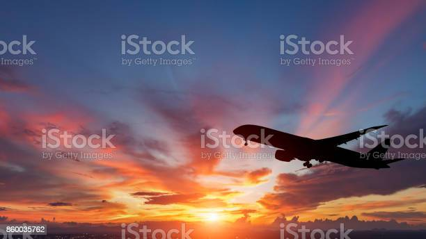 The silhouette of a passenger plane flying in sunset picture id860035762?b=1&k=6&m=860035762&s=612x612&h=tndd26nrxy9eflrdhydajmncpybwr7mjgmwtaqtangs=