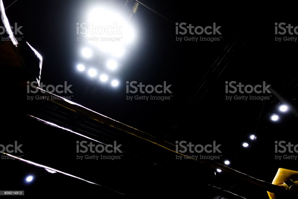 The silhouette of the boxing ring in the dark with the light. stock photo