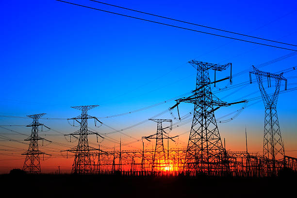 ... The silhouette of the evening electricity transmission pylon stock  photo ...