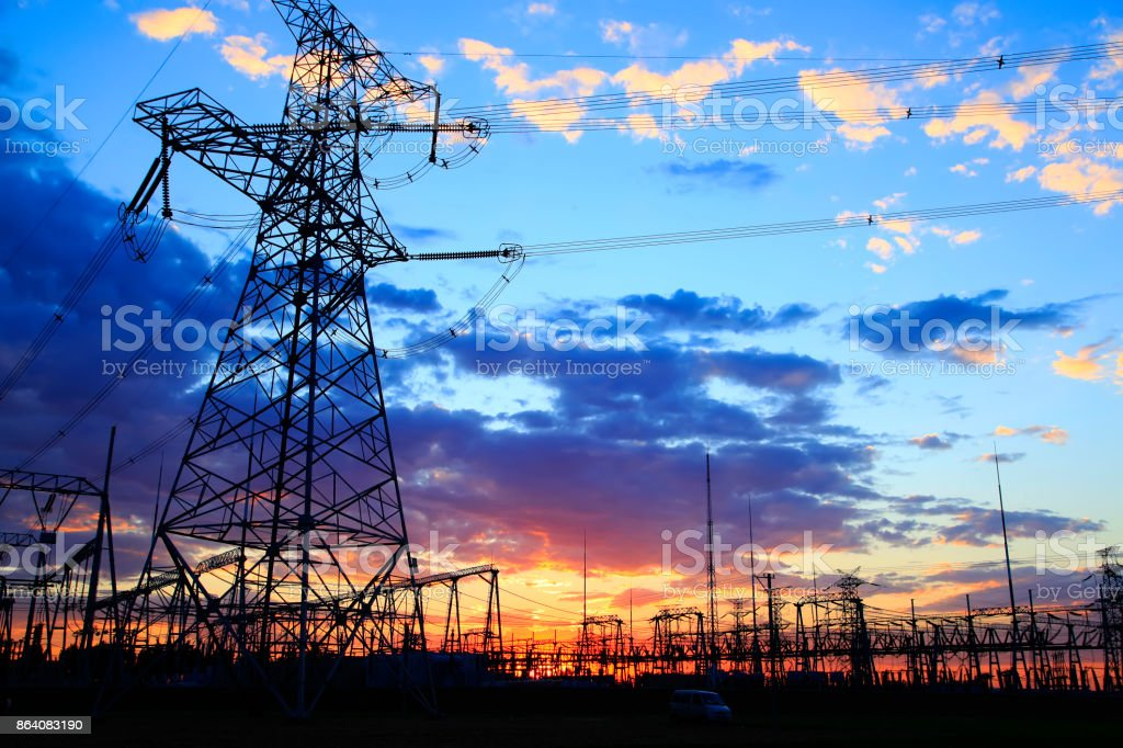 The silhouette of the evening electricity transmission pylon royalty-free stock photo