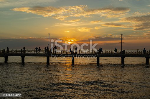 The silhouette of the pier in the sunset.