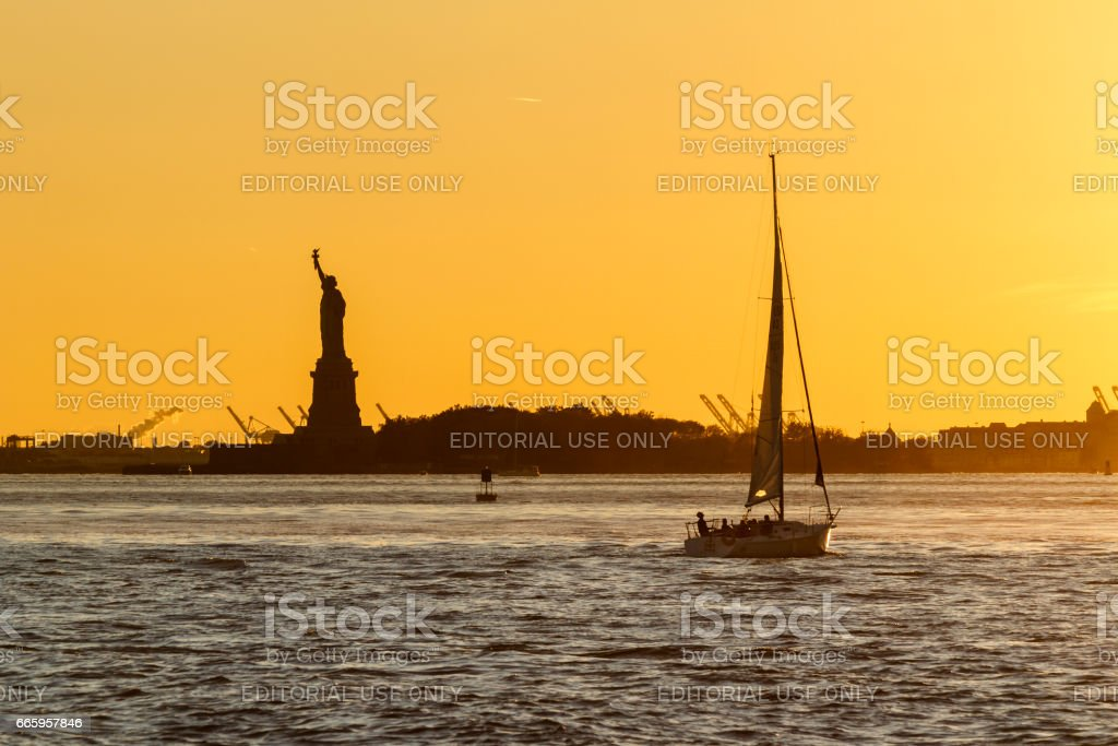 The silhouette of the Statue of Liberty stock photo