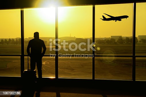 istock The silhouette of the traveler at the airport. 1067002186