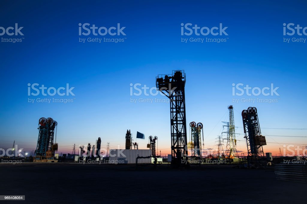 The silhouette of tower type pumping unit royalty-free stock photo
